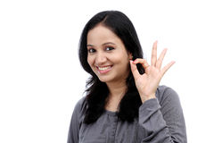 Young woman showing ok gesture Stock Photography