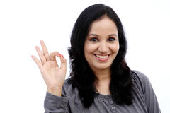 Young woman showing ok gesture Stock Photo