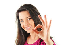 Young woman showing ok isoleated on white Royalty Free Stock Photography