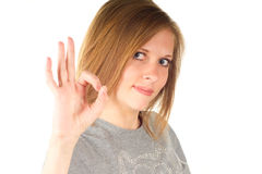 Young woman gesturing okay Stock Photo