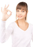 Young woman showing ok sign Royalty Free Stock Images