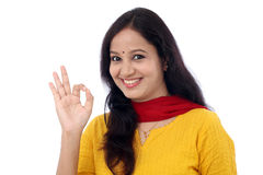 Young woman showing OK sign against white Stock Images
