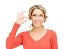Young woman showing ok sign Stock Photos