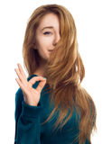 Young woman is showing OK sign over white Stock Photos