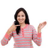 Young woman showing the palm to a blank copy space Stock Image