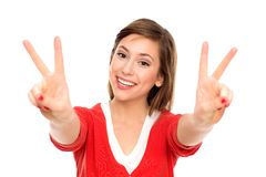 Young woman showing peace sign. Young woman over white background Stock Photos