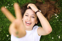 Young woman showing peace sign. Shot of an attractive young woman outdoors Royalty Free Stock Photos