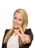 Young woman showing peace sign with her hands Royalty Free Stock Images