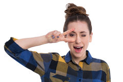 Young woman showing peace sign. Studio shot of an attractive young woman Stock Photo
