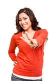 Young woman showing peace or victory sign Royalty Free Stock Photography