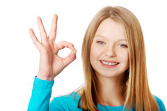 Young woman showing perfect sign Stock Images