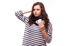 Young woman showing a pill with severe head pain with tablets Stock Images