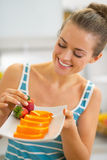 young woman showing plate with orange slices Royalty Free Stock Photo
