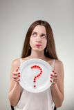 Young woman showing plate. Royalty Free Stock Photos