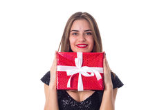 Young woman showing a present Royalty Free Stock Photography
