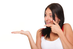 Young woman showing product open hand palm excited expression Stock Photography