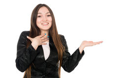 Young woman showing product with open hand palm Royalty Free Stock Images