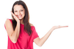 Young woman showing product Stock Photo