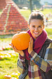 Young woman showing pumpkin Royalty Free Stock Images