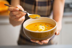 Young woman showing pumpkin soup Royalty Free Stock Image