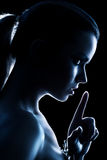 Young woman showing quiet handsign Stock Photography