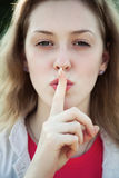 Young woman showing quiet sign Stock Image