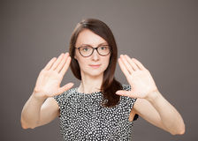 Young woman showing repulsive gesture Royalty Free Stock Images