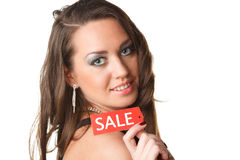 Young woman showing SALE sign Royalty Free Stock Photos