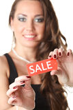 Young woman showing SALE sign Royalty Free Stock Photography