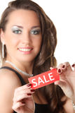 Young woman showing SALE sign Stock Photography