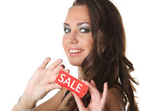 Young woman showing SALE sign Royalty Free Stock Photo