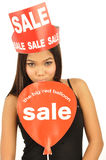 Young woman showing on sale signs Royalty Free Stock Image