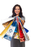 Young woman showing shopping bags Stock Photography