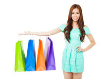 Young woman showing the shopping bags Royalty Free Stock Photography
