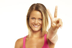Young woman showing the sign of victory royalty free stock images
