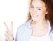 young woman showing the sign of victory Stock Images