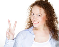 Young woman showing the sign of victory Royalty Free Stock Photo