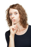 Young woman showing silence sign Stock Photo