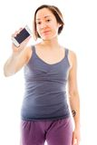 Young woman showing a smart phone Royalty Free Stock Image