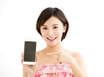 Young woman showing the smart phone royalty free stock photography