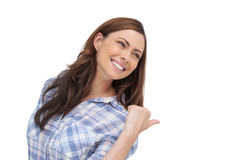 Young woman showing something behind her Royalty Free Stock Image