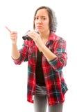 Young woman showing something holding binoculars Royalty Free Stock Photo
