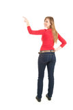 Young woman showing something up, full length Royalty Free Stock Photo