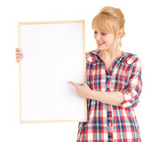 Young woman showing someting at blank poster Stock Photo