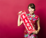 Young  woman showing Spring festival couplets Royalty Free Stock Images