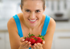 Young woman showing strawberries Royalty Free Stock Photo