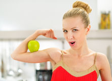 Young woman showing strength of healthy eating Royalty Free Stock Photo
