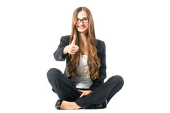 Young woman showing success sitting cross legged Royalty Free Stock Photo