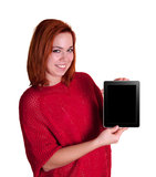 Young Woman Showing Tablet. Beautiful smiling red hair girl showing tablet with blank screen isolated on white stock images