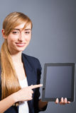 Young woman showing a tablet PC. Stock Photos